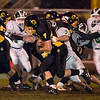Record-Eagle/Jan-Michael Stump<br /> Traverse City Central's Mike Heim (7) gets hit by Traverse City West's Colton Schumont (5) in the first quarter.