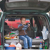 Record-Eagle/Jan-Michael Stump<br /> Samuel Katt (cq), 5, stays dry during his family's tailgate before the start of the Traverse City Central and Traverse City West game Friday at Thirlby Field.
