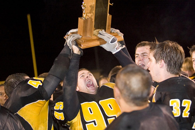 Record-Eagle/Jan-Michael Stump<br /> Traverse City Central's Billy Baesch (99) celebrates with teammates after their 21-14 win over Traverse City West Friday at Thirlby Field.