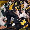 Record-Eagle/Jan-Michael Stump<br /> Traverse City Central's Ben Broad tries to escape Traverse City West's Morgan Tolle (28) Friday at Thirlby Field.