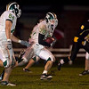 Record-Eagle/Jan-Michael Stump<br /> Traverse City West's Jon Flynn (30) picks up yards against Traverse City Central Friday at Thirlby Field.