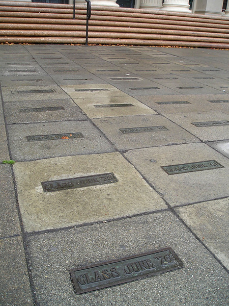 In front of the high school, plaques for each year's class dating from--uh-oh, forgotten already--'20s?--covered the sidewalk.