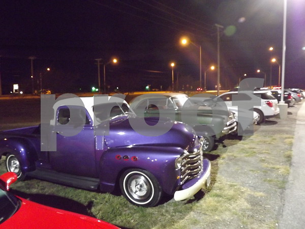 Cars in the parking lot of the dance.