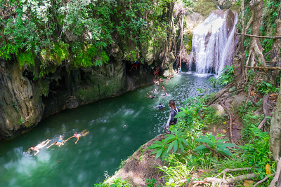 Swimming hole with a waterfall at the end of a 45 minute hike in a national park near the city of Trinidad