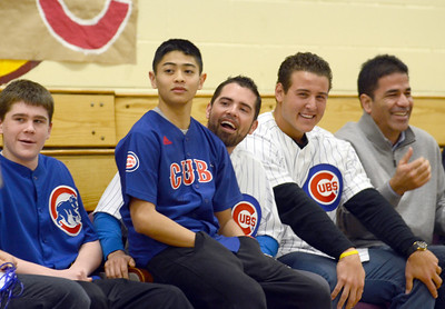 Montini students Chuck Norgle and Eddie LaViste join members of the Cubs David DeJesus and Anthony Rizzo on stage during the Cubs visit to discuss the importance of exercise Wednesday Jan. 16 2013. The two students won an essay competition. Erica Benson—ebenson@shawmedia.com