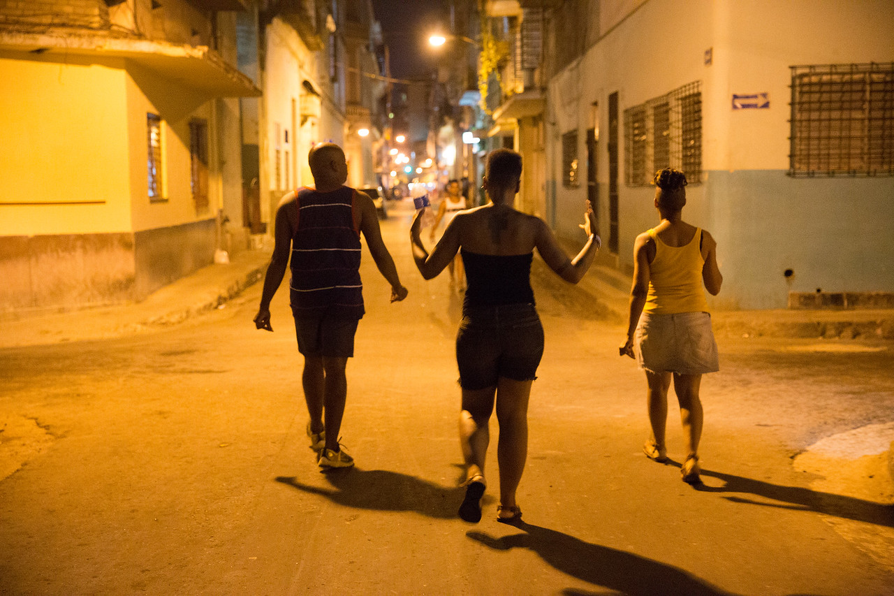 20. From left, Seattle artists Dani Tirrell, Lara Davis and Shontina Vernon sing in the streets of Centro Havana.