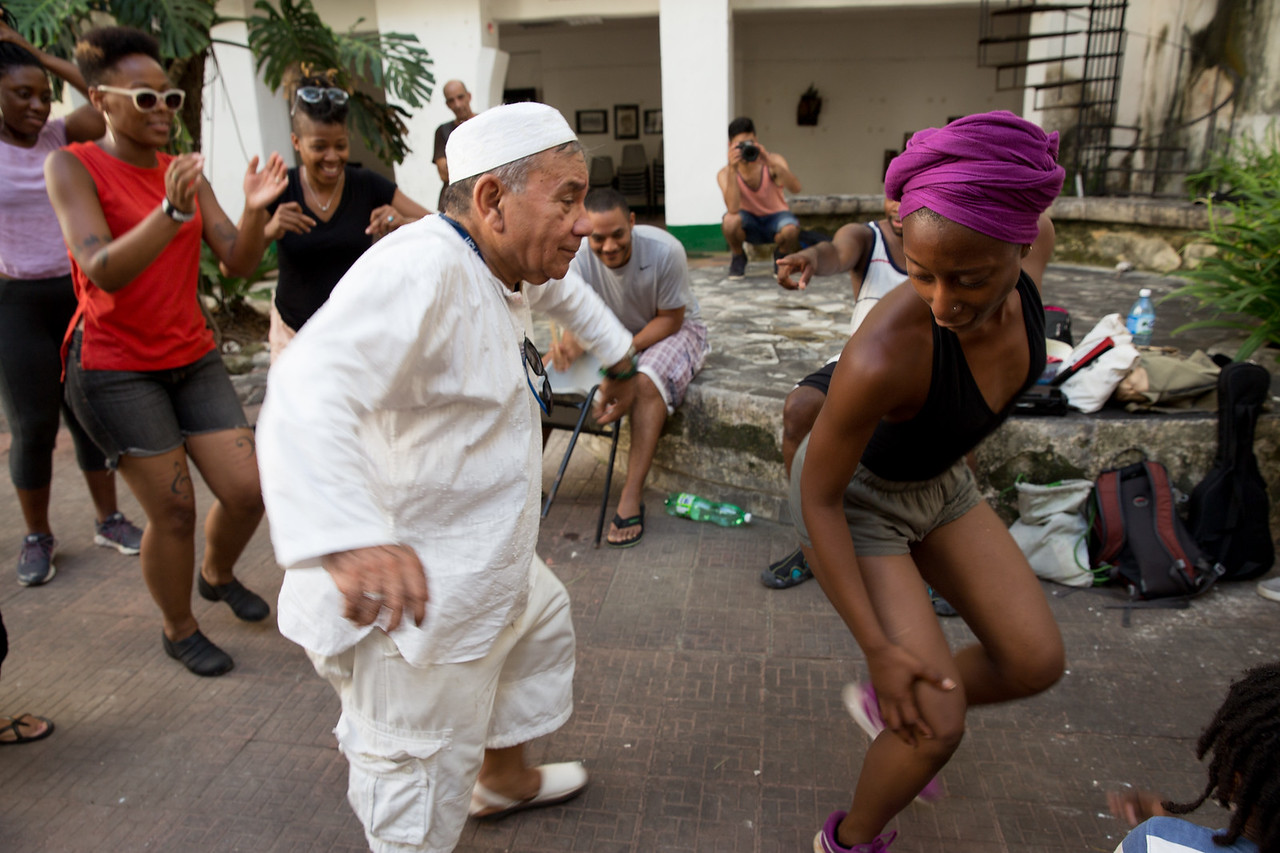 13. Seattle's Jade Solomon Curtis dances with prominent Afro-Cuban author Tomás Fernandez Robaina after a discussion at the Centro Cultural Pablo de la Torriente Brau in Havana.