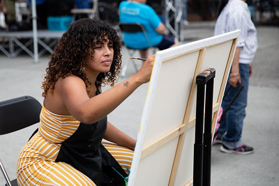 Stephanie Morales of Axsm Art paints during the Block Party.
