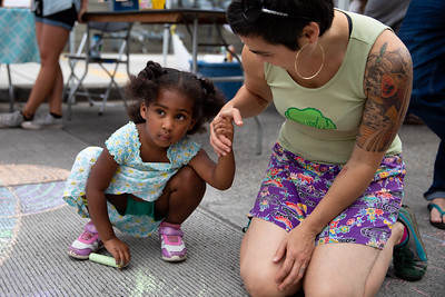 Nevaeh Hollis, 3 and a half,  and her mom, Joselynn, doing chalk art at the Block Party.