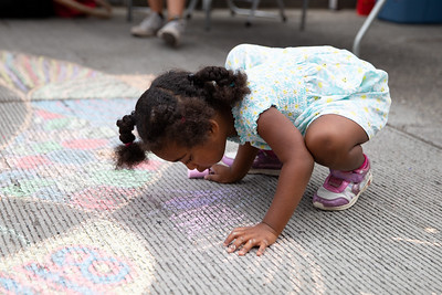 Nevaeh Hollis, 3 and a half,  doing chalk art at the Block Party.