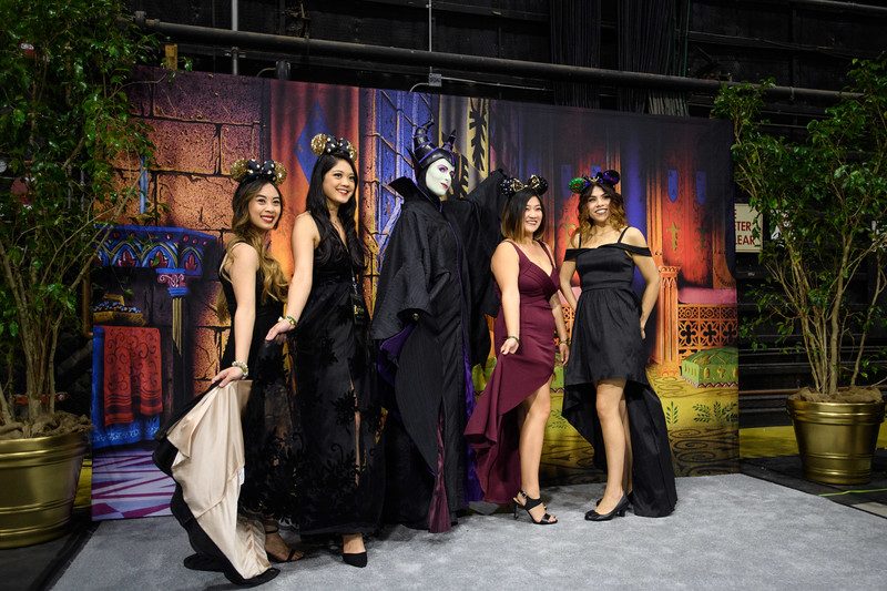 Guests pose with Sleeping Beauty's Maleficent at D23's 10-Year<br /> FAN-niversary Celebration at the Walt Disney Studios, March 10, 2019.