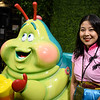 A guest poses with Heimlich's Chew Chew Train on display from<br /> the Walt Disney Archives at D23's 10-Year FAN-niversary Celebration at the<br /> Walt Disney Studios, March 10, 2019.