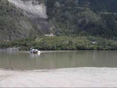 The free ferry MV George Black crossing the Yukon River from Dawson City over to the west side, at the bottom of the grade coming down from the Top Of The World Highway.