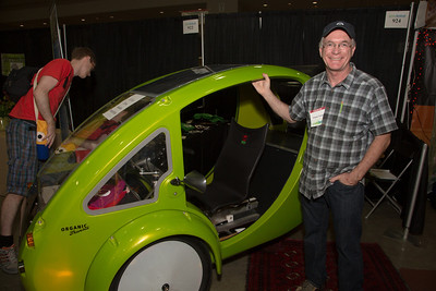 Organic Transit    The ELF  and inventor Rob Cotter. The ELF is a solar/pedal hybrid vehicle suitable for commuting, deliveries, and other local transportation needs. This three-wheeled electric assist velomobile fills the niche between a bicycle and a car and offers advantages over both.