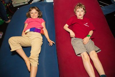 Sophia (age 6), Josh (age 6) watch the puppet show on Yogibo furniture. Yogibo is the new age bean bag furniture store with indoor and outdoor lounge bags, chairs, and seating.