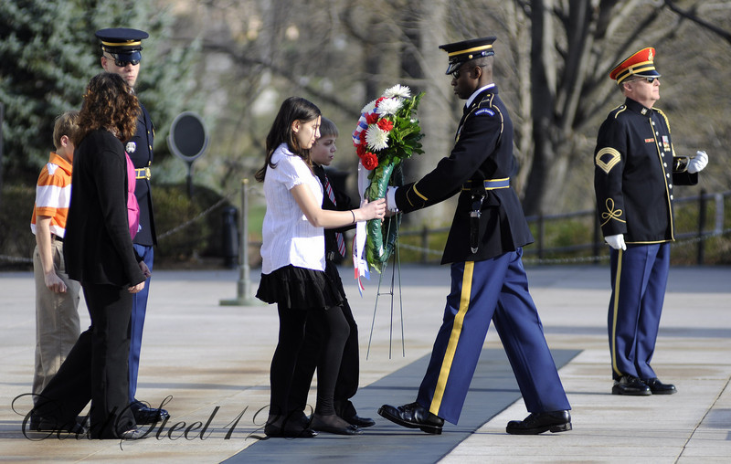 Students laying a wreath at the Tomb of the Unknown Soldier are accompanied by a bugler that plays Taps in lieu of a 21-gun salute.