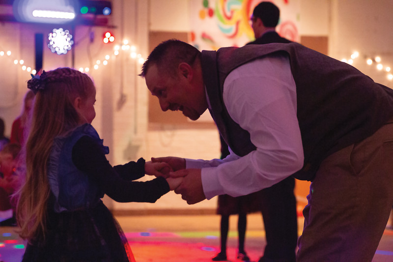 Matthew Gaston | The Sheridan Press<br>Travis Adam bends over to dance with his 5-year-old daughter Corby in order to share the experience on her level during the Daddy Daughter Dance Saturday, Feb. 2, 2019.