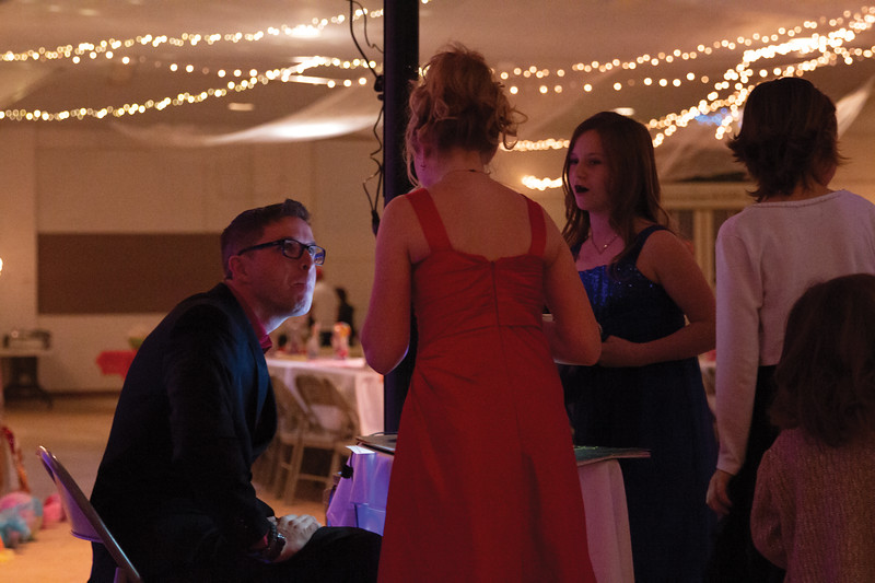 Matthew Gaston | The Sheridan Press<br>D.J. Rick Miller takes requests from a group of young ladies at the Daddy Daughter Dance at the Sheridan County Fairgrounds Saturday, Feb. 2, 2019.
