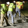 Construction workers scrape off excess concrete debris as they work late into the night at the US23N exit ramp off Stone Drive. Construction work to repair the exit ramp to go towards US23N off Stone Drive began and will be blocked from traffic for the next several days. Excavators are removing the concrete and repairing the surface levels. Construction work occurs mostly at night and motorists are encouraged to take alternate routes. Photo by Erica Yoon