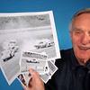 Jim Donaldson poses with some of his photos from Bristol Motor speedway. Photo by David Grace