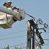 AEP worker starts the process of repairing a power pole on Ft. Henry Drive at the Ft. Henry Mall. The power pole fire was reported at 7:50 a.m. caused power outage to an area in east Kingsport affected the Mall as well as traffic lights on Center Street.