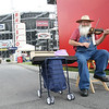 Joel Shimberg of Johnson City, TN plays his fiddle infront of Bristol Motor Speedway to entertain race fans as they come and go at Earnhardt Campgrounds. Photo by Erica Yoon