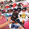 Beula Hill (left) and Stanley Thompson (right) of Akwesasne Ontario, Canada look at hats sporting #88 at a hat vendor inside of Earnhardt Campgrounds on Wednesday. Hill says it took 14 hours to drive down. Photo by Erica Yoon