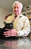 "Allen ""Doc"" Jones poses with his Shadow Wednesday Sept. 26. 2012 in his home office in Blountville. Photo by David Grace"