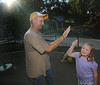Kevin Estep high fives his daughter Kristin as she plays at Darrell's Dream playground. Photo by David Grace