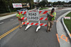 Kingsport transportation employees Trevor Bellamy and Rusty Mays remove the road closed sign on Netherland Inn at the roundabout, reopening the intersection. Photo by David Grace