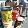Cody Helms, John Graham and Dwayne Foster with Environmental Enterprises Inc of Atkins, VA, crate up some of the home hazardous materials brought in during the annual Scott County county wide hazardous waste collection. The materials will be safely disposed of. Photo by Ned Jilton II