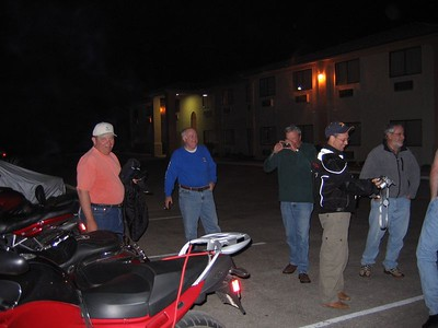 (L to R) - Dave Mock is relieved and happy that it is not his Harley with that huge puddle of oil underneath it, while Ron Musfeldt is thinking about whether his fuel tank is filled... Dean Lear takes a picture of the oil spill in case he needs it for a BMW warranty rep... Doug Smith is adjusting his camera so the reflectivity off the spill won't fry its CCD's, and Brian Gurney wonders if the ST can truly repair itself like Dean claims it can...