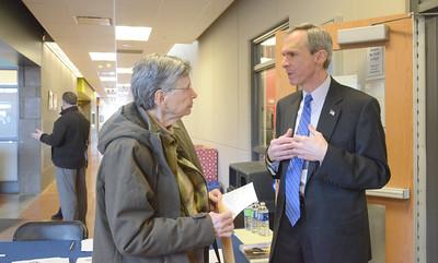 Erica Benson—ebenson@shawmedia.com  Mary Klonowski of La Grange discusses gun violence prevention with Congressman Dan Lipinski during the senior fair held at the CORE Monday Feb. 18 2013.