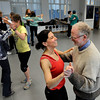 "Maria Sarro, of Boulder, center, laughs as she dances with Mike Kreith, of Louisville, on Saturday, Jan. 7, during Dance Days at the East Boulder Community Center. For more photos and video of the event go to  <a href=""http://www.dailycamera.com"">http://www.dailycamera.com</a><br /> Jeremy Papasso/ Camera"