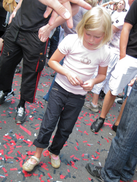 "Girl collecting only the silver ""confetti"""
