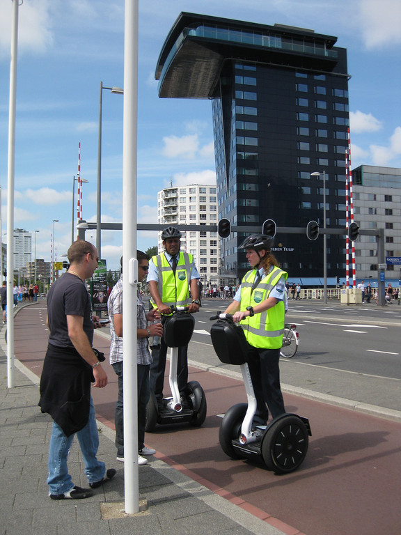 Police on segway being cited by citizen for not being hands-free on the phone!