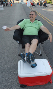 Erica Benson-ebenson@shawmedia.com President of the Westmont Chamber Gregg Pill relaxes prior to the band Souled Out Funk performs during the annual Dancin' in the Street summer concert series Wednesday, June 19 2013. The event is held through the village of Clarendon Hills.