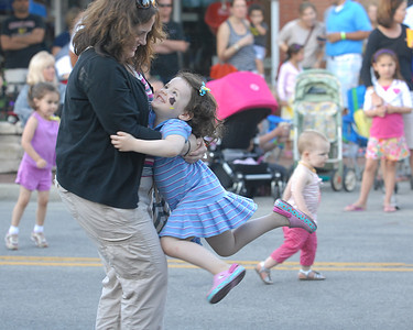 Erica Benson-ebenson@shawmedia.com Jen Forcash of Clarendon Hills dances with her daughter Kendall to the sounds of Souled Out Funk during the annual Dancin' in the Street summer concert series in Clarendon Hills Wednesday, June 19 2013. The event is held through the village of Clarendon Hills.