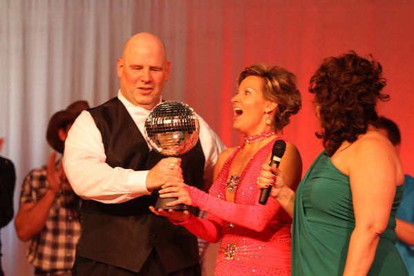 Ed Godby-Schwab and Beth Erskine receive their Judges' Choice winners' trophy at the Dancing Like the Stars event Saturday at the Paramount Theatre.
