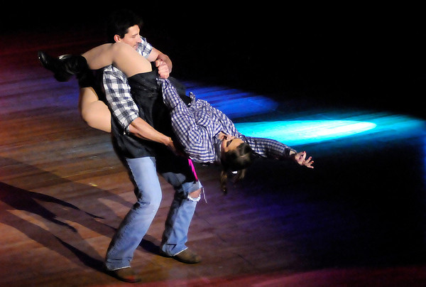 Damon Stansberry dances the East Coast Swing with Sara Pitcher during the 5th Annual Dancing Like the Stars competition at the Paramount on Saturday.