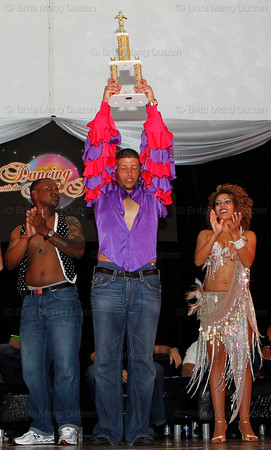 BONITA SPRINGS, FL  March 5, 2011: Boston Red Sox catcher Luis Exposito, center, holds up his trophy as his dance partner, right, and fellow contestant pitcher Jason Rice applaud. (Brita Meng Outzen/Boston Red Sox)