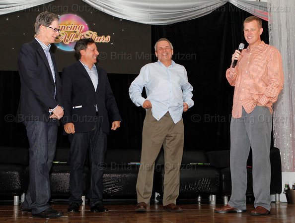 BONITA SPRINGS, FL  March 5, 2011: Boston Red Sox executive vice president and COO Sam Kennedy, right, welcomes guests as (from left) principal owner John Henry, chairman Tom Werner and president and CEO Larry Lucchino look on. (Brita Meng Outzen/Boston Red Sox)