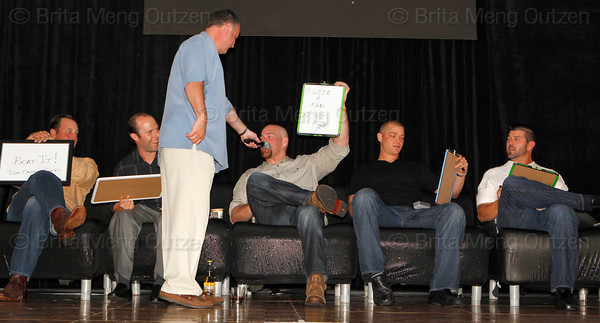 BONITA SPRINGS, FL  March 5, 2011: Emcee Don Orsillo of NESN, third from left, gets Boston Red Sox third baseman and judge Kevin Youkilis' score for catcher Ryan Lavarnway's routine during the Dancing with the New Stars competition as fellow judges, from left, pitcher Tim Wakefield, second baseman Dustin Pedroia, pitcher Michael Bowden and catcher Jason Varitek listen. (Brita Meng Outzen/Boston Red Sox)