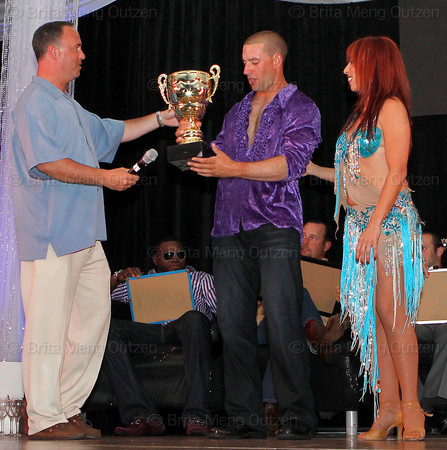 BONITA SPRINGS, FL,  March 5, 2011: Emcee Don Orsillo, left, of NESN presents Boston Red Sox outfielder Ryan Kalish, center, and his partner with the first place trophy. (Brita Meng Outzen/Boston Red Sox)