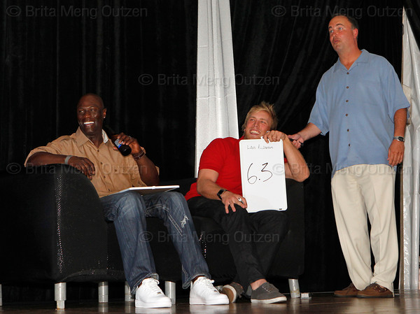 BONITA SPRINGS, FL  March 5, 2011: Emcee Don Orsillo, right, looks a bit surprised by the score judge and Boston Red Sox first baseman Lars Anderson, center, gives catcher Luis Exposito's dance routine while Mike Cameron watches Exposito's reaction. (Brita Meng Outzen/Boston Red Sox)