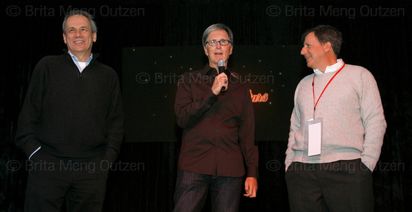 "BONITA SPRINGS, FL, March 6, 2010: Boston Red Sox principal owner John Henry, center, speaks to the crowd as Red Sox president and CEO Larry Lucchino, left, and chairman Tom Werner listen before the ""Dancing with the New Stars"" dance contest. (Brita Meng Outzen/Boston Red Sox)"