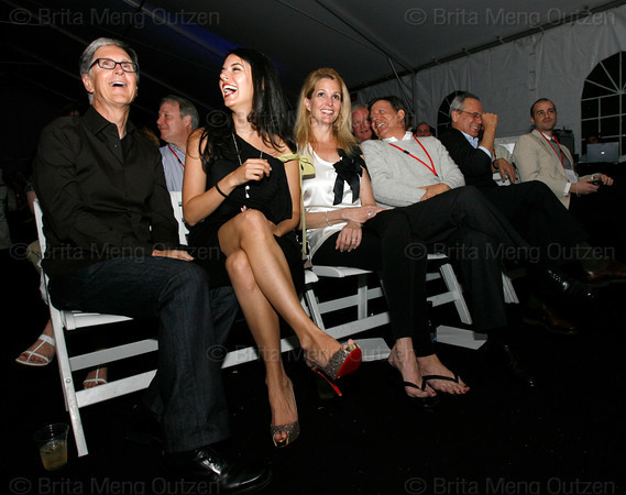 "BONITA SPRINGS, FL, March 6, 2010: From left, Boston Red Sox principal owner John Henry; wife Linda Pizzuti; Stacey Lucchino, wife of Red Sox president and CEO Larry Lucchino; chairman Tom Werner; and Lucchino laugh during the live auction portion of the ""Dancing with the New Stars"" dance contest to benefit the Red Sox Foundation. (Brita Meng Outzen/Boston Red Sox)"