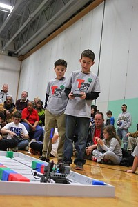 Brayden Spurlock (right and Griffin Minor (left) move their robot to gather blocks.