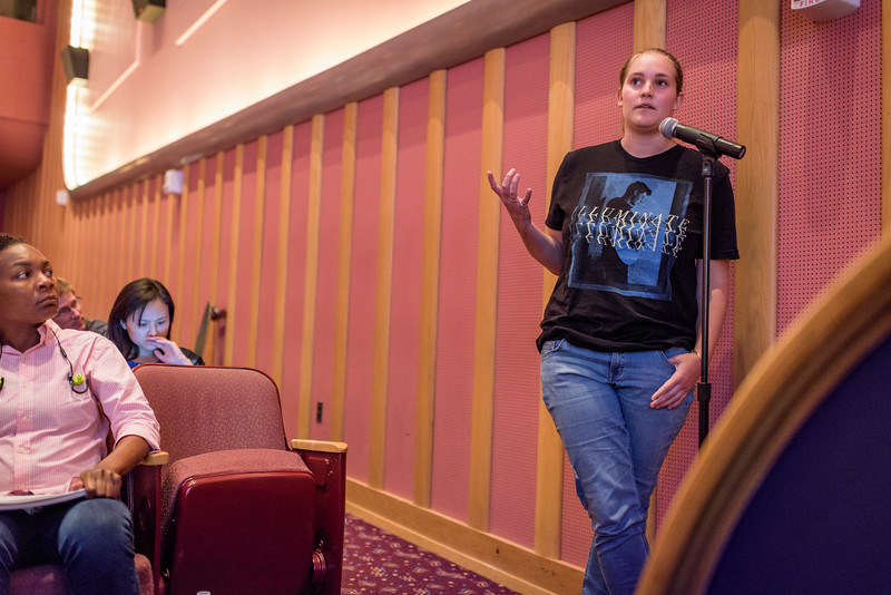 An audience member asks Quentin Hardy a question during the first day of the Dawn Or Doom conference in Fowler Hall. (Purdue University Photo/Alex Kumar)