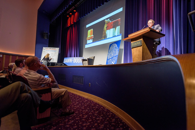 Michael Bess, author and Vanderbilt University professor, speaks during the first day of the Dawn Or Doom conference in Fowler Hall. (Purdue University Photo/Alex Kumar)